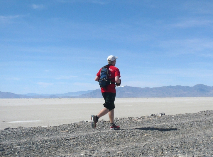 Kevin on dike with salt flats in the distance